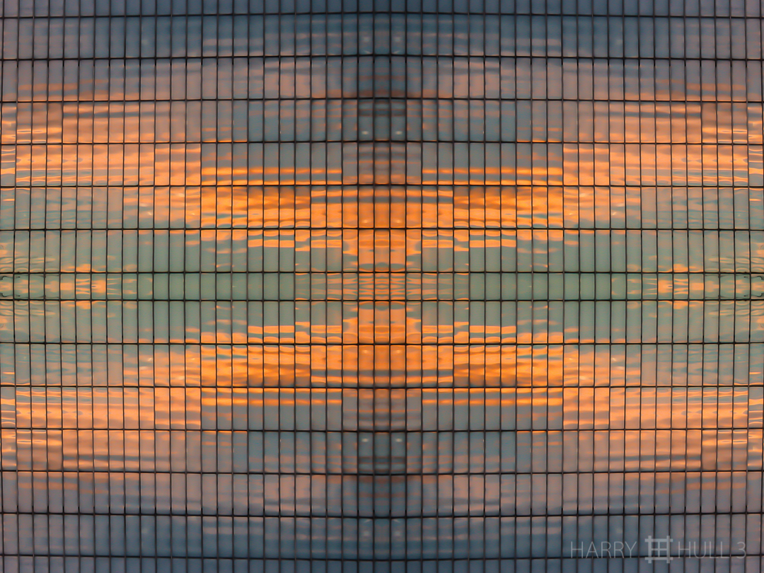 Sunset grid. Photo of sunset reflected in office building, downtown San Francisco, California.
