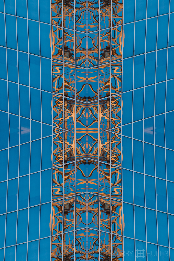 Reflective distortion. Photo of the reflection of a construction crane in the side of a glass-clad building, San Francisco, California.
