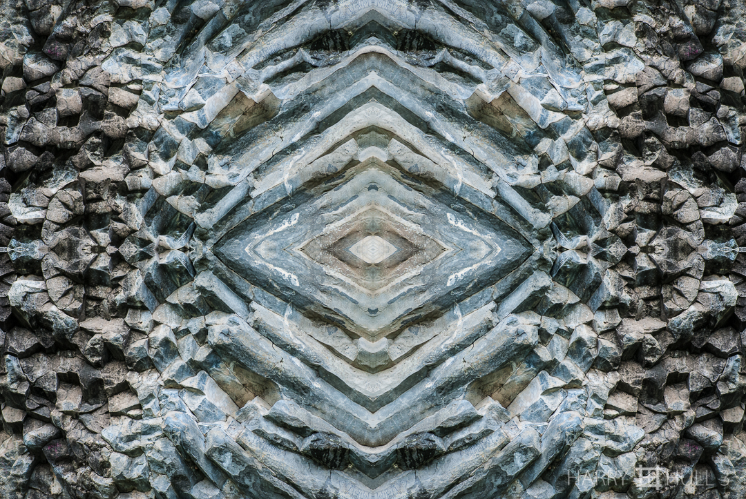 Eye of stone. Photo of basalt rock pattern in a road cut outside of Boquete, Panama.